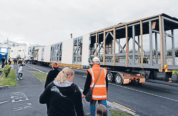 AT A STRETCH: A  prefabricated street-spanning bridge to link parts of Waikato Hospital arrives on site yesterday.