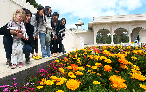 Visitors admire the spring flowers in the Indian Char Bagh Garden at the Hamilton Gardens. From left, three-year-old Danika Bennett, mother Jodi Bennett