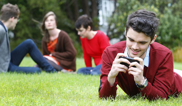 SMARTPHONE USER: Andrew Burns becomes so engrossed in his smartphone that he switches off to people around him. He is already trying to wean himself off it.