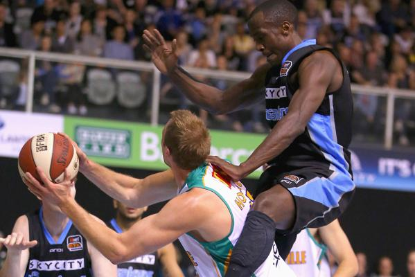 Cedric Jackson of the Breakers rides the shoulders of Jacob Holmes of the Crocs.