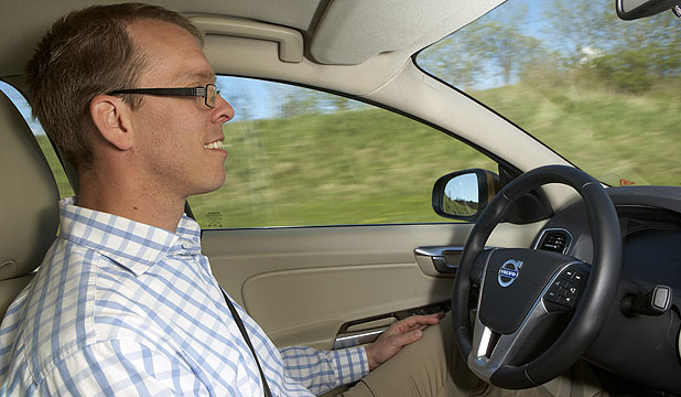 A Volvo technician demonstrates its new traffic jam assistance self-driving technology.