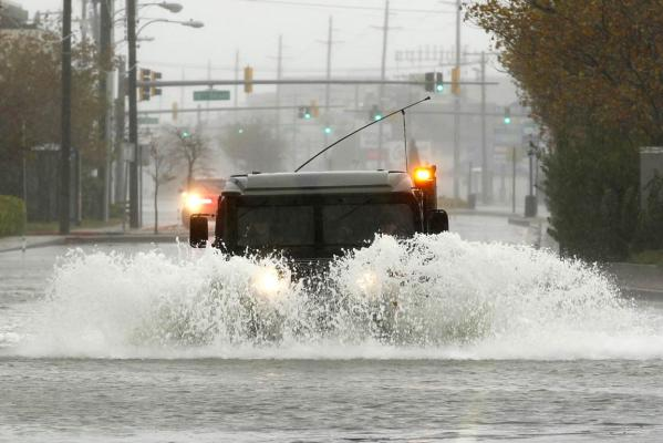 An Army vehicle makes its way down a flooded street in Ocean City, Maryland, as Hurricane Sandy intensifies.