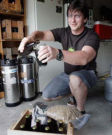Karl Safi at home pouring one of his beers