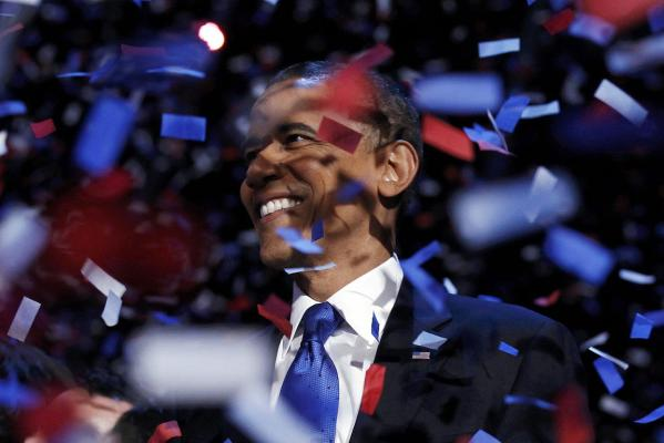 US President Barack Obama celebrates on stage as confetti falls after his victory speech.