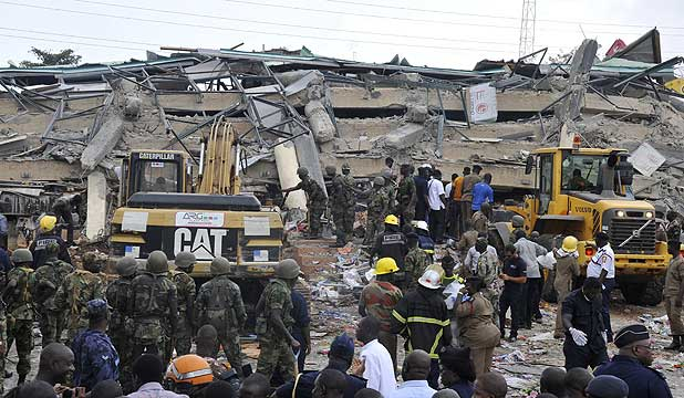 Rescue workers look for survivors from the debris of a collapsed four-storey building in Accra, Ghana.