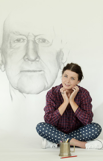 FINE PRINT: Laura Kay with a hand-drawn pencil portrait of her grandfather in her new Waitomo graphic design studio.