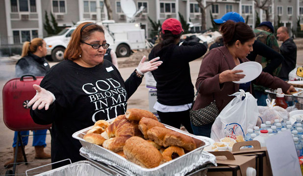 A woman prepares food to be handed out to victims of Hurricane Sandy, in the Rockaway Beach neighbourhood of Queens, New York.
