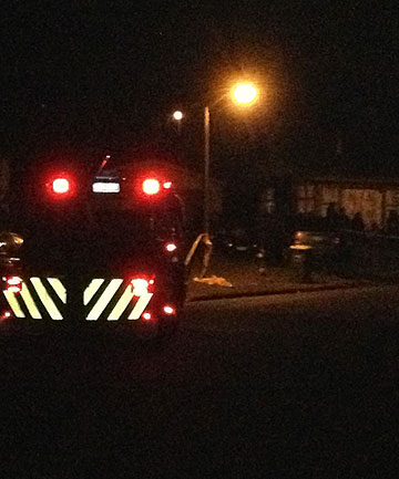 DRIVEWAY DEATH: Emergency services at a street in suburban Papakura where a two-year-old boy was killed after being run over in a driveway. 
