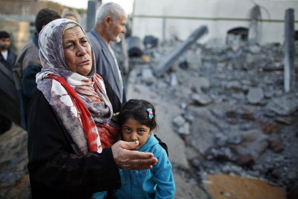 A Palestinian woman cries next to a relative's house after it was destroyed in what witnesses said was an Israeli air strike.