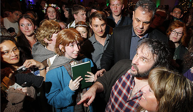 FAN FAVOURITE: Sir Peter Jackson makes a surprise appearance at a Hobbit pre-premiere party in Wellington.