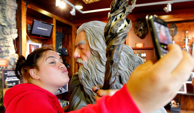 Visitors dropped in at Weta Cave after the premiere of the Hobbit film. Emma Parangi takes her own photo with Gandalf.  