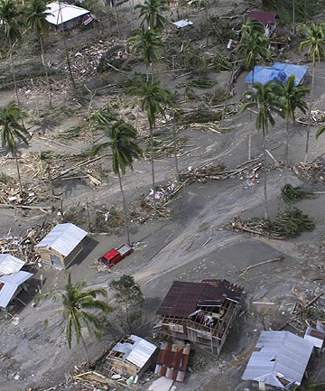 An aerial view of houses damaged by flash floods caused by Typhoon Bopha in Compostela Valley province, in the southern Philippines.