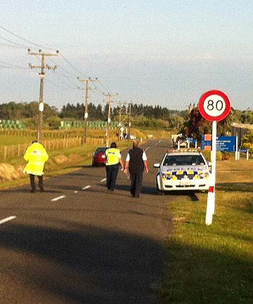 PRISONERS ON ROOF: Police are stationed outside Manawatu Prison.