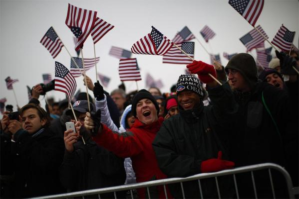Spectators react on the National Mall during the 57th inauguration ceremonies for US President Barack Obama and Vice President Joe Biden.