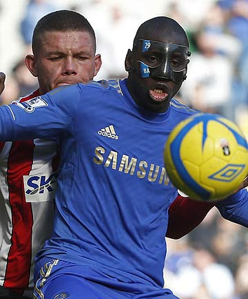 Chelsea's Demba Ba (right) is challenged for the ball by Brentford's Harlee Dean during their FA Cup fourth round replay at Stamford Bridge in London.