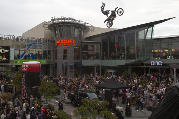 Motocross rider Joe McNaughton performs for the crowd at the Palms Shopping Centre.