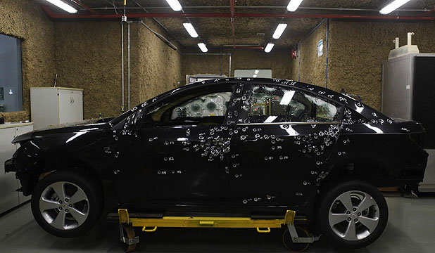 BETTER PROTECTION: A car with bullet holes is seen during a test at the headquarters of Brazil's Dupont laboratory in Paulinia.