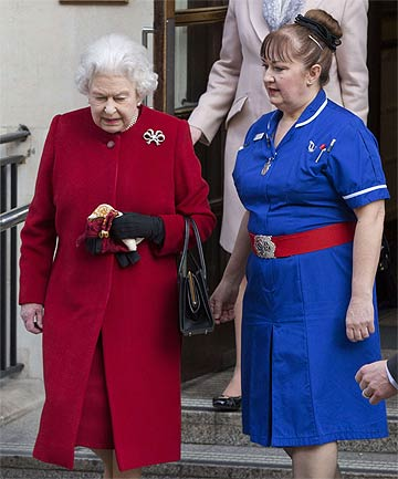 GOING HOME: A smiling Elizabeth walked unassisted out of King Edward VII Hospital.