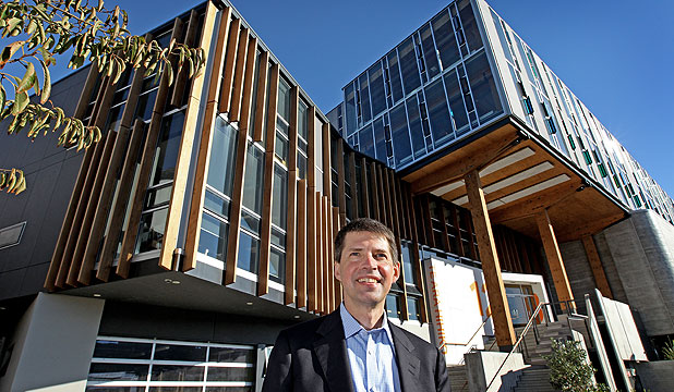 WOODEN IT BE NICE: Canadian architect Tye Farrow at the New College of Creative Arts Building at Massey University.