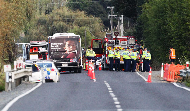 HIGHWAY TRAGEDY: The crash scene on State Highway 16, northwest of Auckland, where a baby, a young boy and a woman were killed.