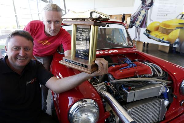 Garry Orton (left) and Mike Wilson with the trophy the team won for breaking a speed record in a Mini at the Bonneville Speed Week in the United States.