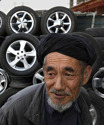 Alambiq, 70, has never owned a car but has long worked fixing tyres and hubcaps in Kabul, Afghanistan. He says he would like to buy an American car.