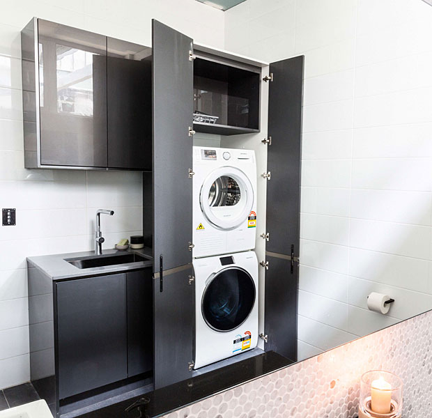 11 clever ways to conceal your laundry for Small bathroom designs with washing machine