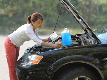 Woman fixing car